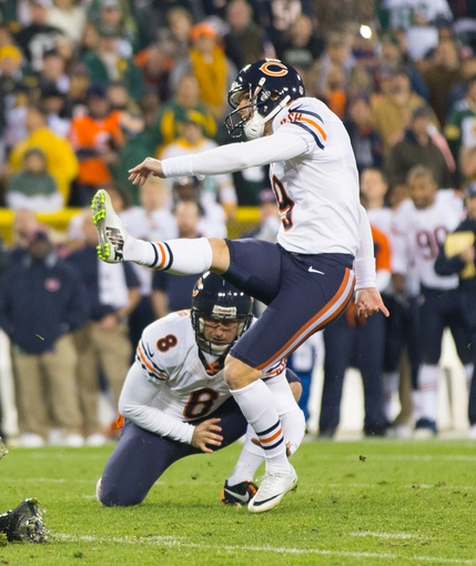 Nov 4, 2013; Green Bay, WI, USA; Chicago Bears kicker Robbie Gould (9) kicks a field goal during the fourth quarter against the Green Bay Packers at Lambeau Field. Chicago won 27-20.  Mandatory Credit: Jeff Hanisch-USA TODAY Sports