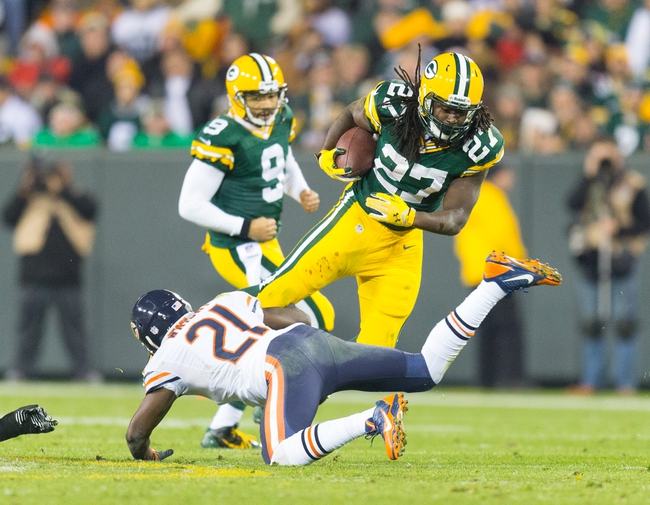 Nov 4, 2013; Green Bay, WI, USA; Green Bay Packers running back Eddie Lacy (27) is tackled by Chicago Bears safety Major Wright (21) during the third quarter at Lambeau Field. Chicago won 27-20.  Mandatory Credit: Jeff Hanisch-USA TODAY Sports