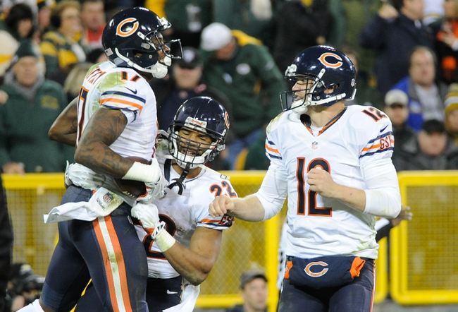 Nov 4, 2013; Green Bay, WI, USA;  Chicago Bears wide receiver Alshon Jeffery (17) celebrates after catching a touchdown pass with running back Matt Forte (22) and quarterback Josh McCown (12) in the 3rd quarter against the Green Bay Packers at Lambeau Field. Mandatory Credit: Benny Sieu-USA TODAY Sports