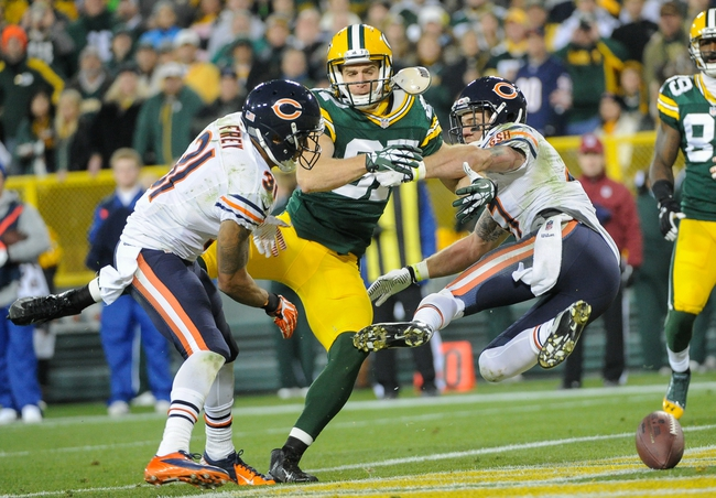 Nov 4, 2013; Green Bay, WI, USA;    Chicago Bears cornerback Isaiah Frey (31) and safety Chris Conte (47) break up a pass intended for Green Bay Packers wide receiver Jordy Nelson (87) in the 3rd quarter at Lambeau Field. Mandatory Credit: Benny Sieu-USA TODAY Sports