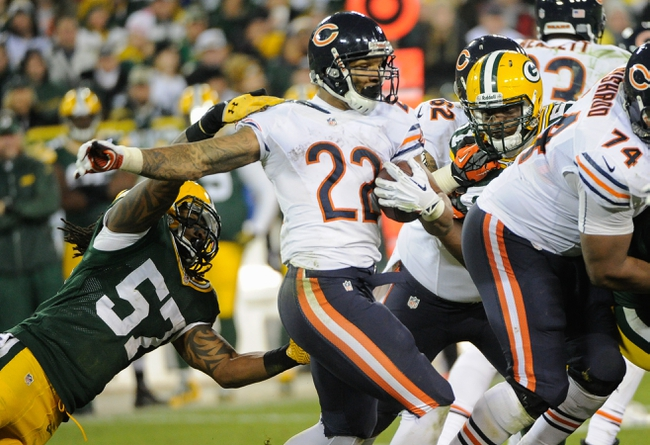 Nov 4, 2013; Green Bay, WI, USA;   Chicago Bears running back Matt Forte (22) tries to break a tackle by Green Bay Packers linebacker Jamari Lattimore (57) in the 4th quarter at Lambeau Field. Mandatory Credit: Benny Sieu-USA TODAY Sports