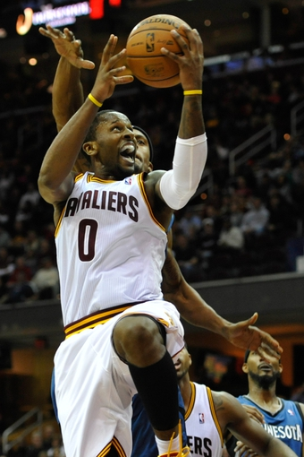 Nov 4, 2013; Cleveland, OH, USA; Cleveland Cavaliers shooting guard C.J. Miles (0) drives to the basket in the fourth quarter against the Minnesota Timberwolves at Quicken Loans Arena. Mandatory Credit: David Richard-USA TODAY Sports