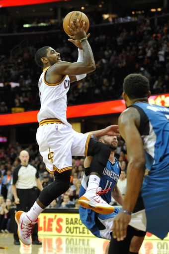 Nov 4, 2013; Cleveland, OH, USA; Cleveland Cavaliers point guard Kyrie Irving (2) drives the lane in the fourth quarter against the Minnesota Timberwolves at Quicken Loans Arena. Mandatory Credit: David Richard-USA TODAY Sports