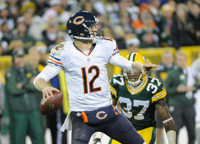 Nov 4, 2013; Green Bay, WI, USA;    Chicago Bears quarterback Josh McCown (12) gets a pass away while getting blitzed by Green Bay Packers cornerback Sam Shields (37) in the 4th quarter at Lambeau Field. Mandatory Credit: Benny Sieu-USA TODAY Sports
