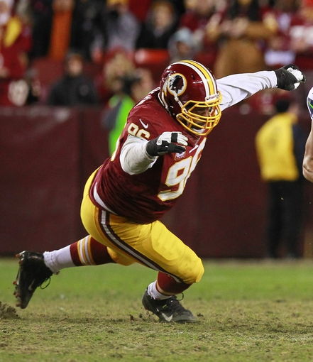 Jan 6, 2013; Landover, MD, USA; Washington Redskins nose tackle Barry Cofield (96) tackles during the NFC Wild Card Playoff game against the Seattle Seahawks at FedEx Field.  The Seahawks win 24-14. Mandatory Credit: Geoff Burke-USA TODAY Sports