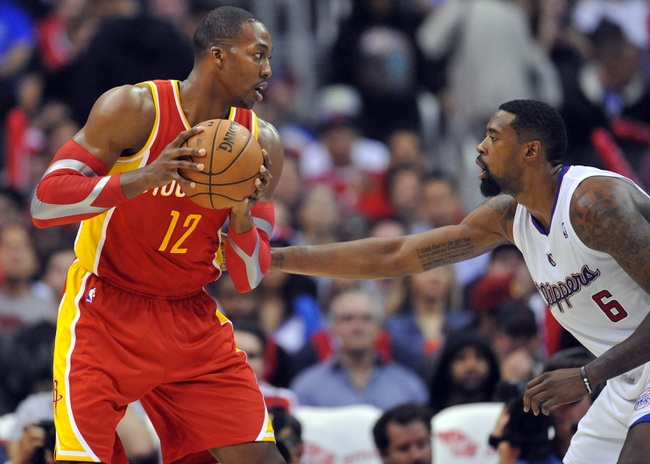 November 4, 2013; Los Angeles, CA, USA; Houston Rockets center Dwight Howard (12) controls the ball against the defense of Los Angeles Clippers center DeAndre Jordan (6) during the second half at Staples Center. Mandatory Credit: Gary A. Vasquez-USA TODAY Sports