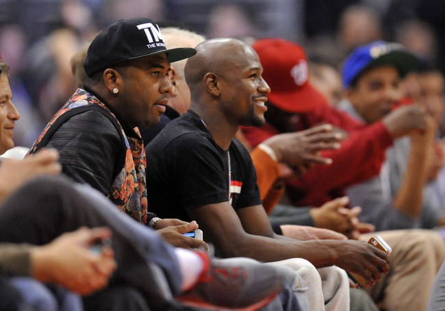 November 4, 2013; Los Angeles, CA, USA; Boxer Floyd Mayweather in attendance watches the Los Angeles Clippers play against the Houston Rockets during the second half at Staples Center. Mandatory Credit: Gary A. Vasquez-USA TODAY Sports