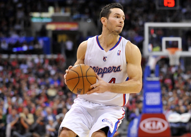 November 4, 2013; Los Angeles, CA, USA; Los Angeles Clippers shooting guard J.J. Redick (4) controls the ball against Houston Rockets during the second half at Staples Center. Mandatory Credit: Gary A. Vasquez-USA TODAY Sports
