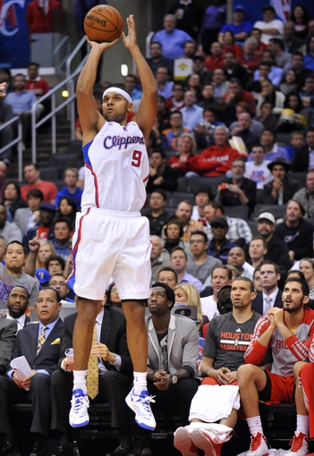 November 4, 2013; Los Angeles, CA, USA; Los Angeles Clippers small forward Jared Dudley (9) shoots a three point basket against Houston Rockets during the second half at Staples Center. Mandatory Credit: Gary A. Vasquez-USA TODAY Sports