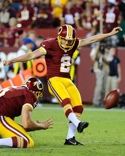 Sep 9, 2013; Landover, MD, USA; Washington Redskins place kicker Kai Forbath (2) attempts an extra point against the Philadelphia Eagles during the second half at FedEX Field. The Eagles won 33 - 27. Mandatory Credit: Brad Mills-USA TODAY Sports
