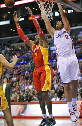 November 4, 2013; Los Angeles, CA, USA; Houston Rockets center Dwight Howard (12) and Los Angeles Clippers center Byron Mullens (0) play for the rebound during the second half at Staples Center. Mandatory Credit: Gary A. Vasquez-USA TODAY Sports
