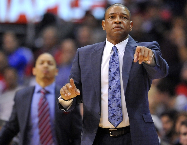 November 4, 2013; Los Angeles, CA, USA; Los Angeles Clippers head coach Doc Rivers watches game action against Houston Rockets during the second half at Staples Center. Mandatory Credit: Gary A. Vasquez-USA TODAY Sports