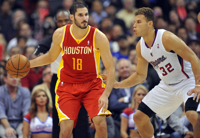 November 4, 2013; Los Angeles, CA, USA; Houston Rockets small forward Omri Casspi (18) moves the ball against the defense of Los Angeles Clippers power forward Blake Griffin (32) during the second half at Staples Center. Mandatory Credit: Gary A. Vasquez-USA TODAY Sports