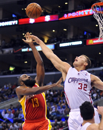 November 4, 2013; Los Angeles, CA, USA; Houston Rockets shooting guard James Harden (13) and Los Angeles Clippers power forward Blake Griffin (32) both play for the rebound during the first half at Staples Center. Mandatory Credit: Gary A. Vasquez-USA TODAY Sports