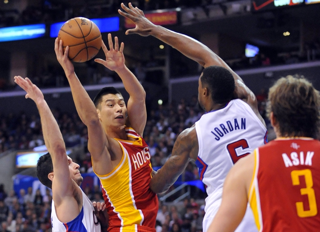 November 4, 2013; Los Angeles, CA, USA; Houston Rockets point guard Jeremy Lin (7) passes the ball against the Los Angeles Clippers defense of center DeAndre Jordan (6) during the first half at Staples Center. Mandatory Credit: Gary A. Vasquez-USA TODAY Sports