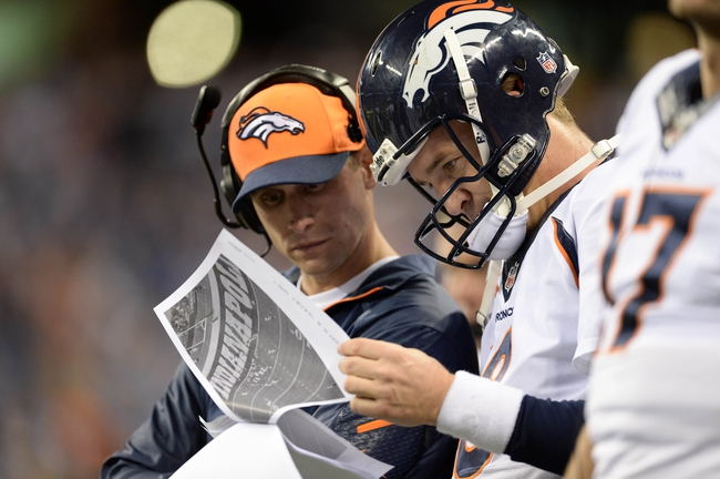Oct 20, 2013; Indianapolis, IN, USA; Denver Broncos quarterback Peyton Manning (18) on the sidelines with offensive coordinator Adam Gase late in the fourth quarter against the Indianapolis Colts at Lucas Oil Stadium. The Colts defeated the Broncos 39-33. Mandatory Credit: Ron Chenoy-USA TODAY Sports