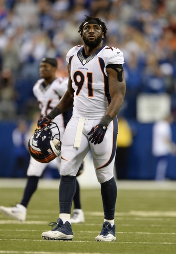 Oct 20, 2013; Indianapolis, IN, USA; Denver Broncos defensive end Robert Ayers (91) leaves the field in the fourth quarter against the Indianapolis Colts at Lucas Oil Stadium. The Colts defeated the Broncos 39-33. Mandatory Credit: Ron Chenoy-USA TODAY Sports