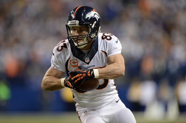 Oct 20, 2013; Indianapolis, IN, USA; Denver Broncos wide receiver Wes Welker (83) runs after a catch in the fourth quarter against the Indianapolis Colts at Lucas Oil Stadium. The Colts defeated the Broncos 39-33. Mandatory Credit: Ron Chenoy-USA TODAY Sports