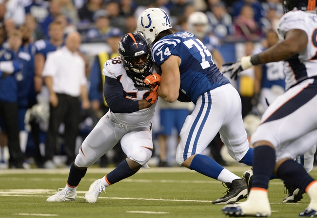 Oct 20, 2013; Indianapolis, IN, USA; Indianapolis Colts tackle Anthony Castonzo (74) pass blocks on Denver Broncos outside linebacker Von Miller (58) in the third quarter at Lucas Oil Stadium. Mandatory Credit: The Colts defeated the Broncos 39-33. Mandatory Credit: Ron Chenoy-USA TODAY Sports