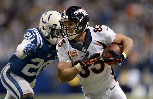 Oct 20, 2013; Indianapolis, IN, USA; Denver Broncos wide receiver Wes Welker (83) is tackled by Indianapolis Colts free safety Darius Butler (20) after a catch in the fourth quarter at Lucas Oil Stadium. The Colts defeated the Broncos 39-33. Mandatory Credit: Ron Chenoy-USA TODAY Sportsncos 39-33.Ron Chenoy-USA TODAY Sports