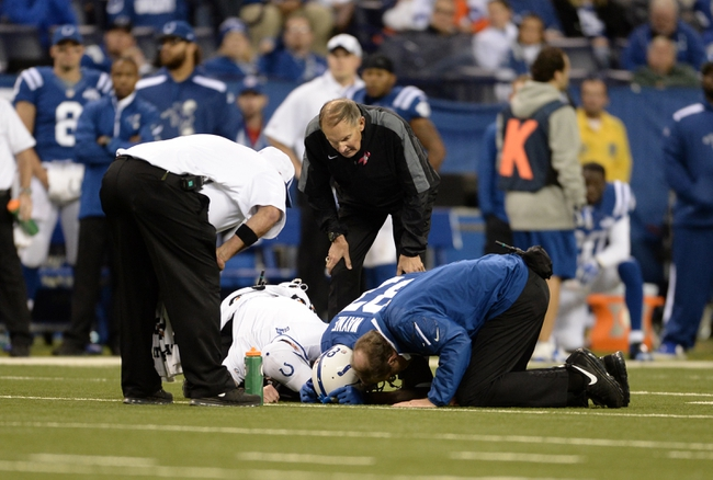 Oct 20, 2013; Indianapolis, IN, USA; Indianapolis Colts wide receiver Reggie Wayne (87) lays injured on the field during the game against the Denver Broncos at Lucas Oil Stadium. The Colts defeated the Broncos 39-33. Mandatory Credit: Ron Chenoy-USA TODAY Sports