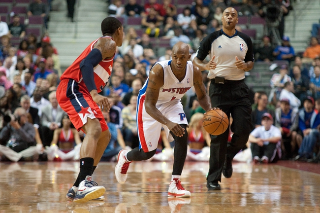 Oct 30, 2013; Auburn Hills, MI, USA; Detroit Pistons point guard Chauncey Billups (1) brings the ball up court against Washington Wizards shooting guard Bradley Beal (3) during the fourth quarter at The Palace of Auburn Hills. Pistons won 113-102. Mandatory Credit: Tim Fuller-USA TODAY Sports