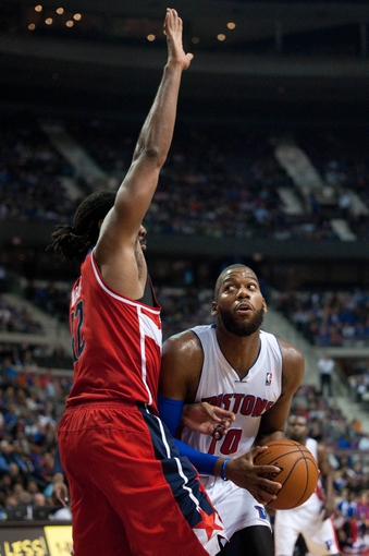 Oct 30, 2013; Auburn Hills, MI, USA; Washington Wizards center Nene (42) guards Detroit Pistons center Greg Monroe (10) during the fourth quarter at The Palace of Auburn Hills. Pistons won 113-102. Mandatory Credit: Tim Fuller-USA TODAY Sports