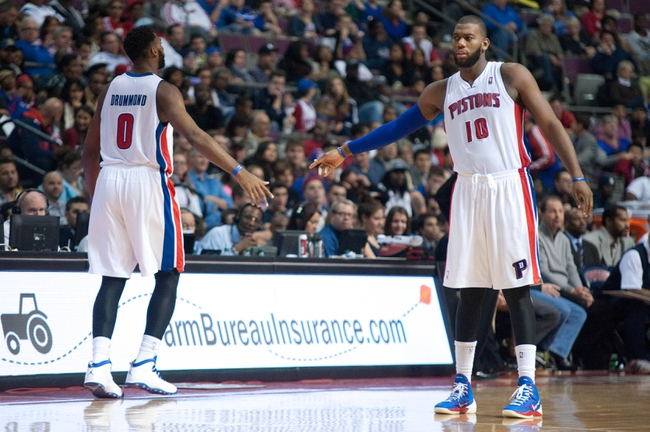Oct 30, 2013; Auburn Hills, MI, USA; Detroit Pistons center Andre Drummond (0) high fives center Greg Monroe (10) during the fourth quarter at The Palace of Auburn Hills. Pistons won 113-102. Mandatory Credit: Tim Fuller-USA TODAY Sports