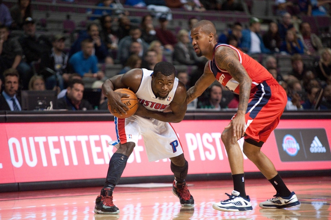 Oct 22, 2013; Auburn Hills, MI, USA; Washington Wizards point guard Eric Maynor (6) guards Detroit Pistons point guard Will Bynum (12) during the fourth quarter at The Palace of Auburn Hills. Pistons won 99-96. Mandatory Credit: Tim Fuller-USA TODAY Sports