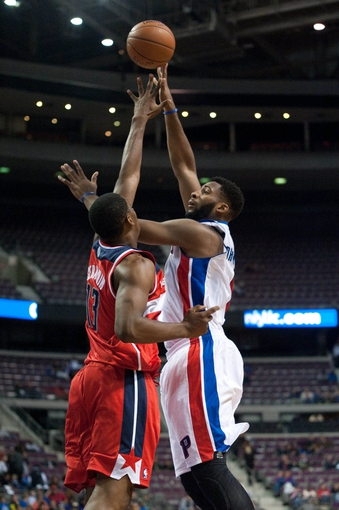 Oct 22, 2013; Auburn Hills, MI, USA; Washington Wizards power forward Kevin Seraphin (13) attempts to block Washington Wizards power forward Kevin Seraphin (13) during the fourth quarter at The Palace of Auburn Hills. Pistons won 99-96. Mandatory Credit: Tim Fuller-USA TODAY Sports