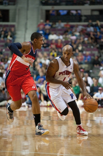 Oct 30, 2013; Auburn Hills, MI, USA; Detroit Pistons point guard Chauncey Billups (1) drives past Washington Wizards shooting guard Bradley Beal (3) during the fourth quarter at The Palace of Auburn Hills. Pistons won 113-102. Mandatory Credit: Tim Fuller-USA TODAY Sports