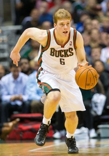 Nov 2, 2013; Milwaukee, WI, USA; Milwaukee Bucks guard Nate Wolters (6) during the game against the Toronto Raptors at BMO Harris Bradley Center. Toronto won 97-90.  Mandatory Credit: Jeff Hanisch-USA TODAY Sports