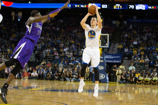 Nov 2, 2013; Oakland, CA, USA; Golden State Warriors point guard Nemanja Nedovic (8) shoots the ball against Sacramento Kings center Hamady Ndiaye (55) during the fourth quarter at Oracle Arena. The Golden State Warriors defeated the Sacramento Kings 98-87. Mandatory Credit: Kelley L Cox-USA TODAY Sports