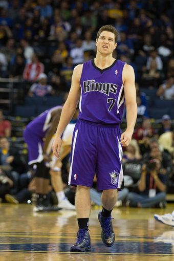 Nov 2, 2013; Oakland, CA, USA; Sacramento Kings point guard Jimmer Fredette (7) reacts after a play against the Golden State Warriors during the fourth quarter at Oracle Arena. The Golden State Warriors defeated the Sacramento Kings 98-87. Mandatory Credit: Kelley L Cox-USA TODAY Sports