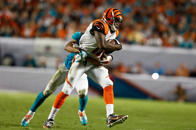 Oct 31, 2013; Miami Gardens, FL, USA; Cincinnati Bengals wide receiver Mohamed Sanu (12) catches a pass in front of Miami Dolphins cornerback Brent Grimes  in the second half at Sun Life Stadium.  Miami won 22-20. Mandatory Credit: Robert Mayer-USA TODAY Sports