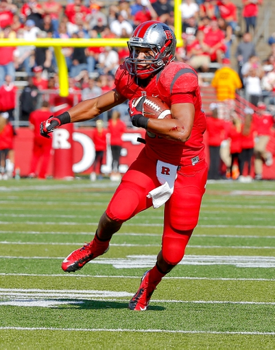 Nov 2, 2013; Piscataway, NJ, USA;  Rutgers Scarlet Knights running back Justin Goodwin (32) turns up field after a pass reception during the first half against the Temple Owls at High Points Solutions Stadium. Mandatory Credit: Jim O'Connor-USA TODAY Sports