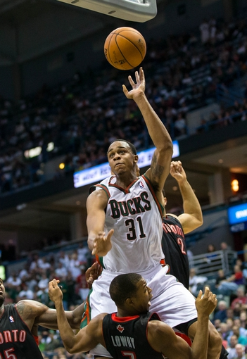 Nov 2, 2013; Milwaukee, WI, USA; Milwaukee Bucks forward John Henson (31) during the game against the Toronto Raptors at BMO Harris Bradley Center. Toronto won 97-90.  Mandatory Credit: Jeff Hanisch-USA TODAY Sports