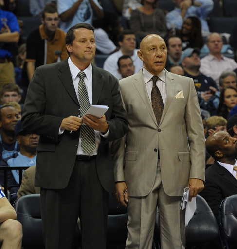 Nov 1, 2013; Memphis, TN, USA; Detroit Pistons assistant coach John Loyer (left) and assistant coach Henry Bibby during a time out against Memphis Grizzlies at FedExForum. Memphis Grizzlies beat the Detroit Pistons 111 - 108. Mandatory Credit: Justin Ford-USA TODAY Sports