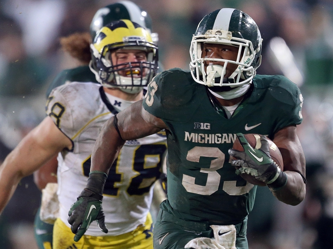 Nov 2, 2013; East Lansing, MI, USA; Michigan State Spartans running back Jeremy Langford (33) is chased by Michigan Wolverines linebacker Desmond Morgan (48) during the 2nd half of a game at Spartan Stadium. MSU won 29-6. Mandatory Credit: Mike Carter-USA TODAY Sports