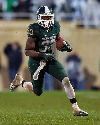 Nov 2, 2013; East Lansing, MI, USA; Michigan State Spartans running back Jeremy Langford (33) run the ball during the 2nd half of a game against the Michigan Wolverines at Spartan Stadium. MSU won 29-6. Mandatory Credit: Mike Carter-USA TODAY Sports
