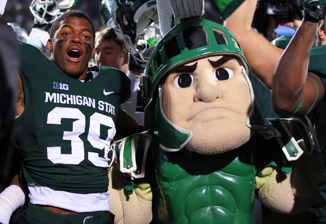 Nov 2, 2013; East Lansing, MI, USA; Michigan State Spartans cornerback Jermaine Edmondson (39) celebrates with Sparty  after a game against the Michigan Wolverines at Spartan Stadium. Mandatory Credit: Mike Carter-USA TODAY Sports
