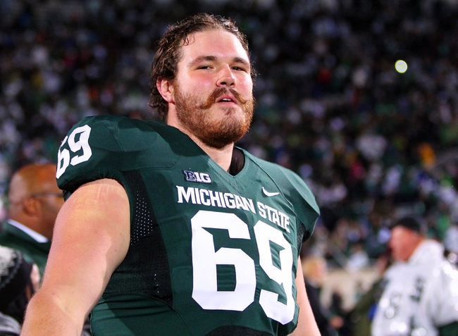 Nov 2, 2013; East Lansing, MI, USA;  Michigan State Spartans offensive tackle Shawn Kamm (69) celebrates the win over the Michigan Wolverines after a game at Spartan Stadium. Mandatory Credit: Mike Carter-USA TODAY Sports
