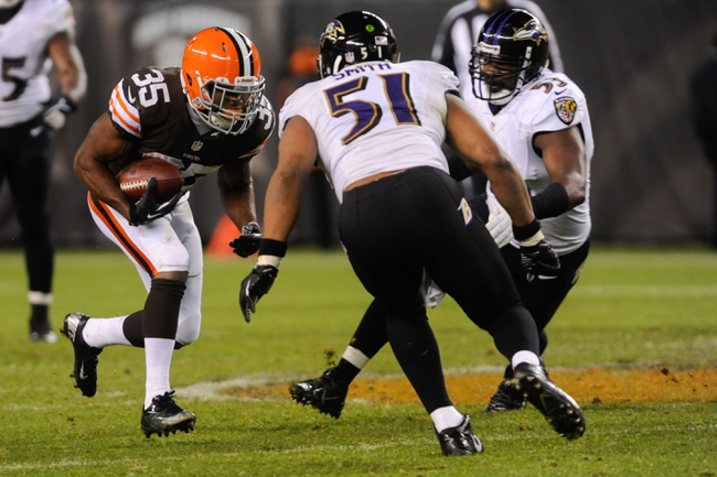 Nov 3, 2013; Cleveland, OH, USA; Cleveland Browns running back Fozzy Whittaker (35) runs against Baltimore Ravens inside linebacker Daryl Smith (51) and Ravens inside linebacker Jameel McClain (53) at FirstEnergy Stadium. Mandatory Credit: Ken Blaze-USA TODAY Sports