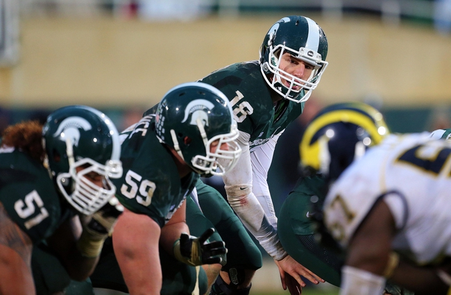 Nov 2, 2013; East Lansing, MI, USA; Michigan State Spartans quarterback Connor Cook (18) takes the snap during the 2nd half of a game at Spartan Stadium. MSU won 29-6. Mandatory Credit: Mike Carter-USA TODAY Sports
