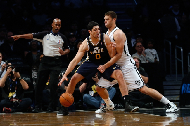Nov 5, 2013; Brooklyn, NY, USA;   Brooklyn Nets center Brook Lopez (11) defends Utah Jazz center Enes Kanter (0) during the first quarter at Barclays Center. Mandatory Credit: Anthony Gruppuso-USA TODAY Sports