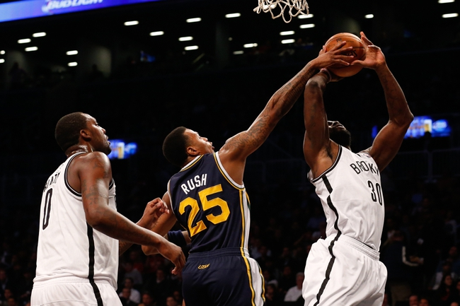 Nov 5, 2013; Brooklyn, NY, USA;  Utah Jazz shooting guard Brandon Rush (25) fouls Brooklyn Nets power forward Reggie Evans (30) during the first quarter at Barclays Center. Mandatory Credit: Anthony Gruppuso-USA TODAY Sports