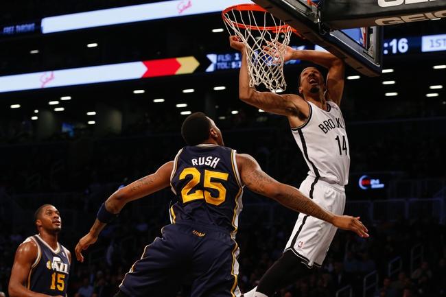 Nov 5, 2013; Brooklyn, NY, USA;  Utah Jazz shooting guard Brandon Rush (25) fouls Brooklyn Nets point guard Shaun Livingston (14) during the first quarter at Barclays Center. Mandatory Credit: Anthony Gruppuso-USA TODAY Sports