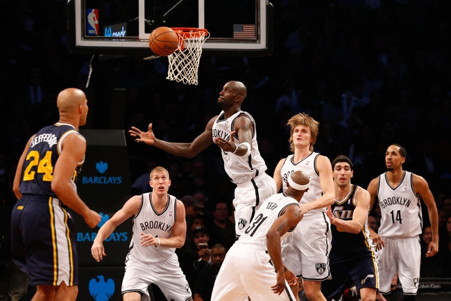 Nov 5, 2013; Brooklyn, NY, USA;  Brooklyn Nets power forward Kevin Garnett (2) reaches for the rebound during the second quarter against the Utah Jazz at Barclays Center. Mandatory Credit: Anthony Gruppuso-USA TODAY Sports