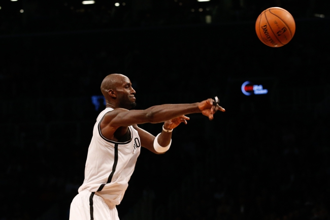 Nov 5, 2013; Brooklyn, NY, USA; Brooklyn Nets power forward Kevin Garnett (2) passes during the second quarter against the Utah Jazz at Barclays Center. Mandatory Credit: Anthony Gruppuso-USA TODAY Sports