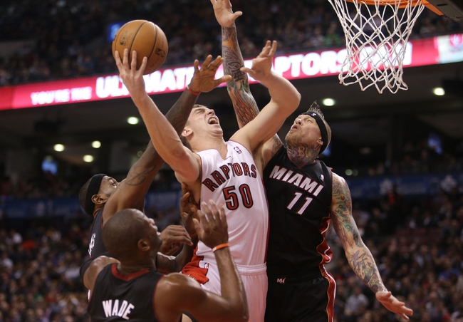 Nov 5, 2013; Toronto, Ontario, CAN; Toronto Raptors forward Tyler Hansbrough (50) is fouled as he goes to the basket against Miami Heat forward Chris Andersen (11) and forward LeBron James (6) at Air Canada Centre. The Heat beat the Raptors 104-95. Mandatory Credit: Tom Szczerbowski-USA TODAY Sports